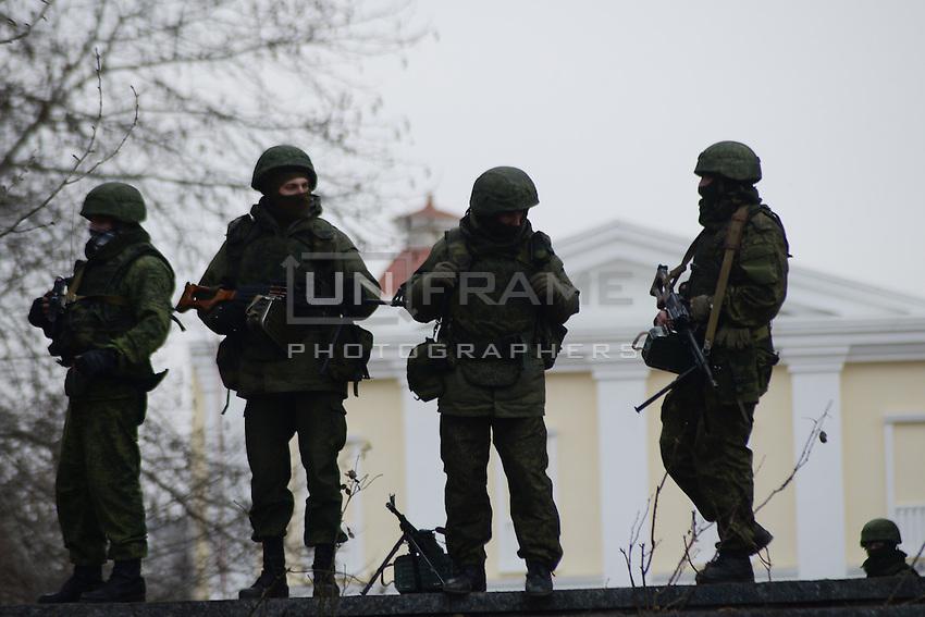 Armed men in military attire and gear surround the parliament in Simferopol, Crimea, Ukraine
