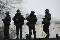 Armed men in military attire and gear surround the parliament in Simferopol, Crimea, Ukraine