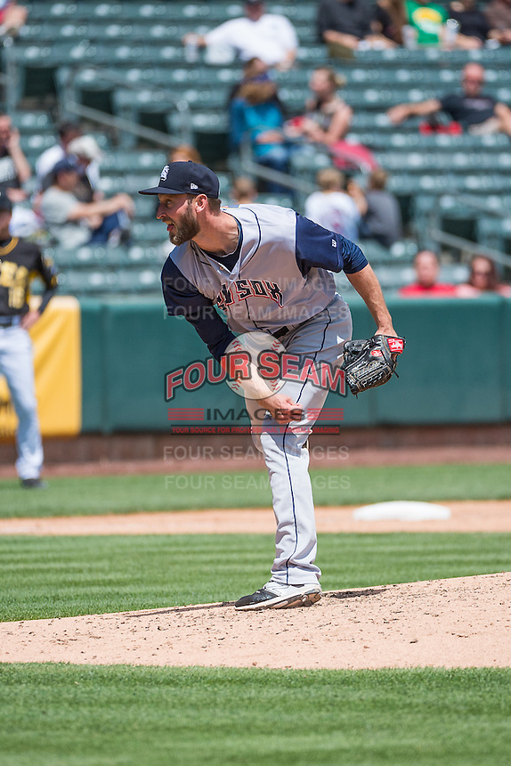 Jim Henderson (39) of the Colorado Springs Sky Sox delivers a pitch to the plate against the Salt Lake Bees in Pacific Coast League action at Smith's Ballpark on May 24, 2015 in Salt Lake City, Utah.  (Stephen Smith/Four Seam Images)