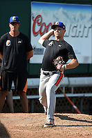 Aberdeen IronBirds pitcher Luc Rennie (34) throws a bullpen as pitching coach Justin Lord (33) looks on before a game against the Williamsport Crosscutters on August 4, 2014 at Bowman Field in Williamsport, Pennsylvania.  Aberdeen defeated Williamsport 6-3.  (Mike Janes/Four Seam Images)
