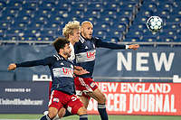 FOXBOROUGH, MA - OCTOBER 16: Ryan Spaulding #34 of New England Revolution II, Thomas Roberts #23 of North Texas SC and Tiago Mendonca #33 of New England Revolution II after a high ball during a game between North Texas SC and New England Revolution II at Gillette Stadium on October 16, 2020 in Foxborough, Massachusetts.