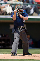 Home plate umpire R.J. Thompson makes a strike call at Knights Castle April 9, 2009 in Fort Mill, South Carolina. (Photo by Brian Westerholt / Four Seam Images)
