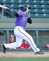 Shortstop Hunter Burton (1) of the Furman Paladins hits in a game against the Miami (Ohio) Redhawks on Sunday, February 17, 2013, at Fluor Field at the West End in Greenville, South Carolina. Furman won, 6-5. (Tom Priddy/Four Seam Images)