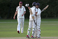 Jonathan Das and Naivedyam Dwivedi celebrate Wanstead's victory during Brentwood CC vs Wanstead and Snaresbrook CC, Essex Cricket League Cricket at The Old County Ground on 12th September 2020