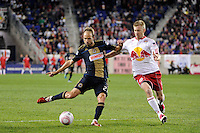 Justin Mapp (22) of the Philadelphia Union is defended by Tim Ream (5) of the New York Red Bulls. The New York Red Bulls defeated the Philadelphia Union  1-0 during a Major League Soccer (MLS) match at Red Bull Arena in Harrison, NJ, on October 20, 2011.