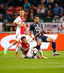 Nederland, Amsterdam, 15 augustus 2015<br /> Eredivisie<br /> Seizoen 2015-2016<br /> Ajax-Willem ll (3-0)<br /> Jairo Riedewald (l.) van Ajax en Bruno Andrade van Willem ll strijden in een duel om de bal.