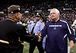 December 2009: Dallas Cowboys head coach Wade Phillips, right, shakes hands with New Orleans Saints head coach Sean Payton, left, after an NFL football game at the Louisiana Superdome in New Orleans.  The Cowboys defeated the Saints 24-17.