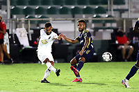 CARY, NC - AUGUST 01: Bruno Lapa #8 shoots the ball past DJ Taylor #27 during a game between Birmingham Legion FC and North Carolina FC at Sahlen's Stadium at WakeMed Soccer Park on August 01, 2020 in Cary, North Carolina.