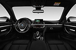 Stock photo of straight dashboard view of a 2018 BMW 4 Series 430i 2 Door Coupe