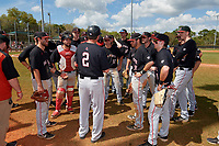 Ball State Cardinals head coach Rich Maloney (2) talks with his team after a game against the Saint Joseph's Hawks on March 9, 2019 at North Charlotte Regional Park in Port Charlotte, Florida.  Ball State defeated Saint Joseph's 7-5.  (Mike Janes/Four Seam Images)