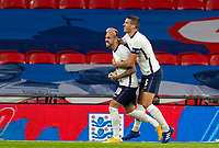8th Occtober 2020, Wembley Stadium, London, England;  Englands Danny Ings celebrates after scoring with teammate Conor Coady during a friendly match between England and Wales in London