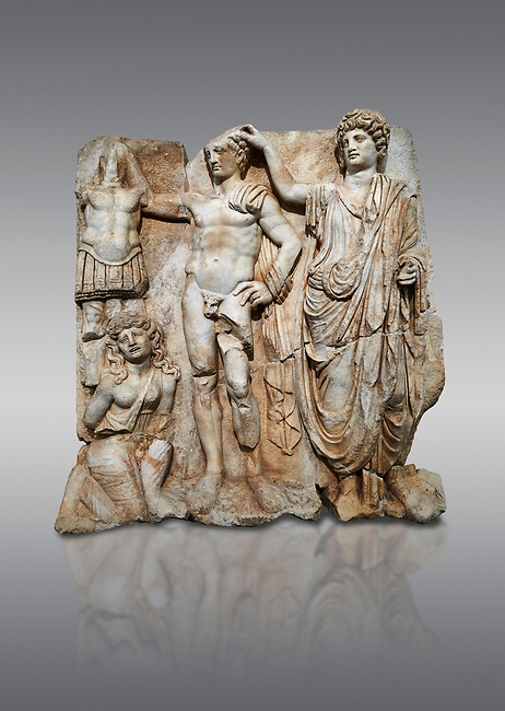 """Roman Sebasteion relief  sculpture of the Emperor and Roman People, Aphrodisias Museum, Aphrodisias, Turkey. <br /> <br /> The emperor is a naked warrior and is crowned by a personification of the Roman People or the Senate wearing a toga, the stately civilian dress of a Roman Citizen. The crown is an oak wreath, the corona civica or """"civic crown"""" awarded for saving citizens lives. The emperor is setting up a battlefield trophy beneath which kneels an anguished barbarian women captive"""