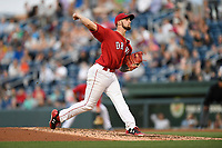 Starting pitcher Alex Scherff (18) of the Greenville Drive delivers a pitch in a game against the Charleston RiverDogs on Friday, April 27, 2018, at Fluor Field at the West End in Greenville, South Carolina. Greenville won, 5-4. (Tom Priddy/Four Seam Images)