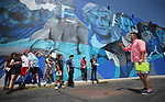 Mark Salinas, Carson City's arts and culture coordinator, right, takes a group of Boys & Girls Club members on a tour of local murals in Carson City, Nev., on Monday, July 31, 2017. <br />