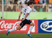 Jack McInerney dribbles the ball. US Under-17 Men's National Team defeated United Arab Emirates 1-0 at Gateway International  Stadium in Ijebu-Ode, Nigeria on November 1, 2009.