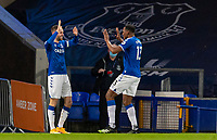 19th December 2020, Goodison Park, Liverpool, England;  Evertons Yerry Mina celebrates with teammate Gylfi Sigurdsson after scoring the winning second goal during the Premier League match between Everton FC and Arsenal FC