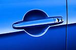 Closeup of a blue car door handle on a 2010 Mitsubishi Lancer Sportback