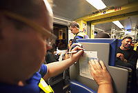 Switzerland. Canton Ticino. Two police officers from TPO (Transport Police) are controlling the train tickets' validity of passengers travelling late at night on a TILO train between Lugano and Chiasso. A policeman gives a fine to a passenger travelling without ticket. TPO (Transport Police) is the Swiss Federal Railways Police. Swiss Federal Railways (German: Schweizerische Bundesbahnen (SBB), French: Chemins de fer fédéraux suisses (CFF), Italian: Ferrovie federali svizzere (FFS)) is the national railway company of Switzerland. It is usually referred to by the initials of its German, French and Italian names, as SBB CFF FFS. TILO (Treni Regionali Ticino Lombardia) creates efficient train connections between the towns in the canton Ticino. 23.07.2017 © 2017 Didier Ruef