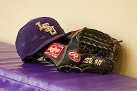 A LSU Tigers hat and glove sit on the bench in the home dugout prior to the game against the Wake Forest Demon Deacons at Alex Box Stadium on February 18, 2011 in Baton Rouge, Louisiana.  The Tigers defeated the Demon Deacons 15-4.  Photo by Brian Westerholt / Four Seam Images