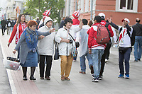 YEKATERINBURG, RUSSIA - June 21, 2018:  Russian fans wave hello to Peru fans walking to their game against France in their 2018 FIFA World Cup group stage at Yekaterinburg Arena Stadium.