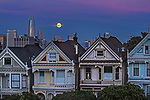 """November's full moon rose over the iconic """"Painted Ladies"""" victorians one of the most photographed location in San Francisco, Alamo Square's famous """"postcard row"""" at Hayes and Steiners Street."""