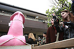 Apr 04, 2010 - Kawasaki, Japan - Visitors take picture of a large pink phallus during the Kanamara Matsuri (Festival of the Steel Phallus) held in Wakamiya Hachimangu Shrine on April 4, 2010 in Kawasaki, Japan. The annual feritility festival, held traditionally the first Sunday in April, is said to encourage fertility and bring harmony to married couples. The festival has also become somewhat of a tourist attraction and is used to raise money for HIV research and awareness of AIDS prevention.