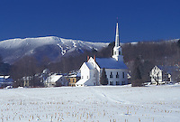 Mad River, church, Vermont, Mad River Valley, VT, Scenic view of the United Church of Christ in the village of Waitsfield with the snow-covered Green Mountains and Sugarbush Ski Area in the background in winter.