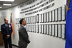 Nevada National Guard Adjutant General Brig. Gen. Bill Burks, left, and Gov. Brian Sandoval talk before a Nevada National Guard Combat Veterans Remembrance Day ceremony in Carson City, Nev., on Friday, April 17, 2015. A tribute wall with the names of about 2,700 Nevada National Guard Soldiers and Airmen deployed into combat zones since Sept. 11, 2001 was unveiled. <br /> Photo by Cathleen Allison