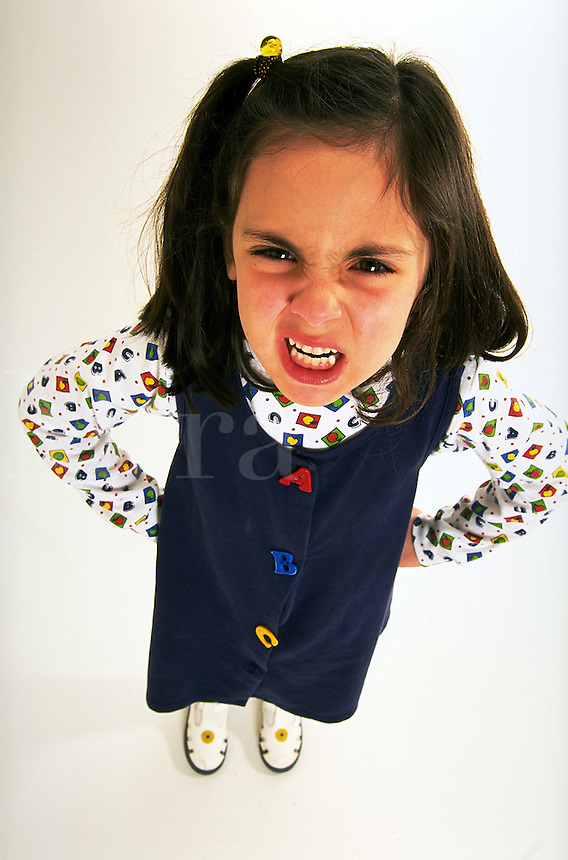 Portrait of a young girl with an angry expression.