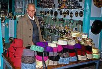Tunisia.  Tunis Medina.  Chechia (Traditional Hat) Vendor.