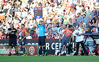 Swansea City's Yan Dhanda takes instructions from Swansea City assistant  manager Billy Read during the Sky Bet Championship match between Sheffield United and Swansea City at Bramall Lane, Sheffield, England, UK. Saturday 04 August 2018