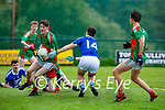 Kilcummin's  Turlough O'Connor clears his defence as  Laune Rangers are in attacking mode in the opening round of the County MFL on Monday evening.