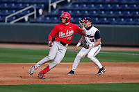 Right fielder Kade Kern (46) of the Ohio State Buckeyes rounds first base in a game against the Illinois Fighting Illini on Friday, March 5, 2021, at Fluor Field at the West End in Greenville, South Carolina. The first baseman is Kellen Sarver. (Tom Priddy/Four Seam Images)
