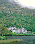 County Galway, Ireland<br /> Kylemore Abbey under the slopes of the Twelve Bens, Kylemore Lough, Connemara region