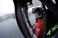 Rescue professional Arne Sveinhaug  check his side of the helicopter during a flight with Norwegian Air Ambulance.