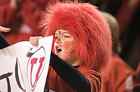 23 December 2006: A young Utah fan cheers from the stands during the 2006 Bell Helicopters Armed Forces Bowl between The University of Tulsa and The University of Utah at Amon G. Carter Stadium in Fort Worth, TX.