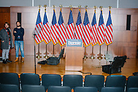 """An empty podium and American flags stand on stage after Democratic presidential candidate and Vermont senator Bernie Sanders delivered his response to President Donald Trump's State of the Union address earlier that night at The Currier Museum of Art in Manchester, New Hampshire, on Tue., Feb. 4, 2020. Sanders' speech began, """"Tonight, we just listened to Donald Trump's third, and what I believe will be his very last, State of the Union Address."""""""