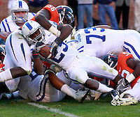 CHARLOTTESVILLE, VA- NOVEMBER 12:  Running back Juwan Thompson #23 of the Duke Blue Devils scores a touchdown despite efforts from defensive end Cam Johnson #56 of the Virginia Cavaliers during the game on November 12, 2011 at Scott Stadium in Charlottesville, Virginia. Virginia defeated Duke 31-21. (Photo by Andrew Shurtleff/Getty Images) *** Local Caption *** Juwan Thompson;Cam Johnson