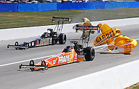 Sept. 6, 2010; Clermont, IN, USA; NHRA top fuel dragster driver Cory McClenathan (near) after defeating teammate Tony Schumacher in the semi finals during the U.S. Nationals at O'Reilly Raceway Park at Indianapolis. Mandatory Credit: Mark J. Rebilas-