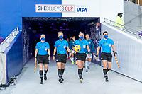 ORLANDO, FL - FEBRUARY 21: Referees Brooke Mayo, Jennifer Garner, Katja Koroleva and Tori Penso enter the field before a game between Canada and Argentina at Exploria Stadium on February 21, 2021 in Orlando, Florida.