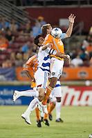Houston Dynamo midfielder Stuart Holden (22) and FC Dallas midfielder Marcelo Saragosa (5) attempt to control the ball.  Houston Dynamo defeated FC Dallas 1-0 at Robertson Stadium in Houston, TX on May 9, 2009