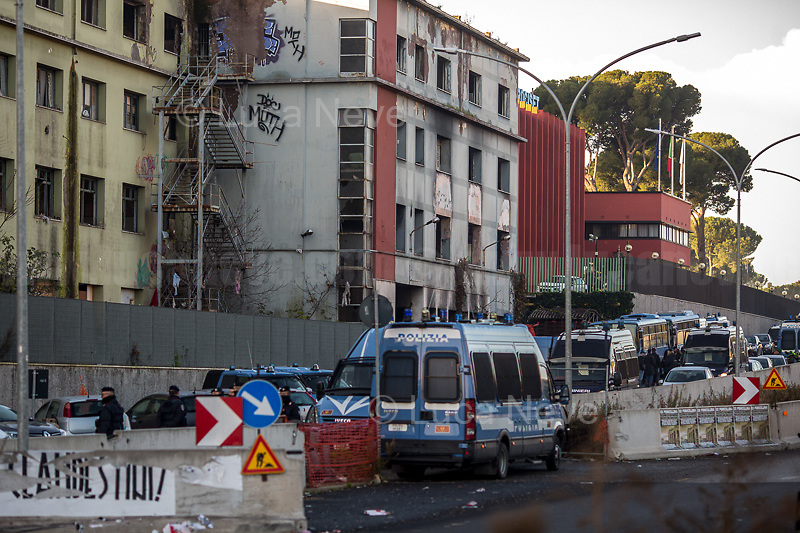(On the L) Posters by the neo-fascist group Casapound.<br /> <br /> Rome, 10/12/2018. Today, the derelict former factory of the Penicillin in the east area of Rome was evicted and evacuated by a conspicuous number police officers in full riot gears (Polizia and Carabinieri) supported by fire fighters and the Rome municipal police. The abandoned and run-down factory once was home to an estimated 500 people, including migrants of different nationalities but also Italian families who lived in extreme poverty and poor hygienic and health conditions (presence of asbestos and others). The eviction, which saw the last 35 inhabitants took away on a bus by the police, was attended by the far-right leader of League (Lega), anti-immigration Minister of the Interiors and Deputy Prime Minister, Matteo Salvini. A group of protesters and activists held a rally against the eviction without a plan to rehouse the people of the Ex Penicillin but it was kept away from the main gate of the raw-concrete skeleton building.<br /> On the same day the 70th Anniversary of the Universal Declaration of Human Rights (UDHR, 1.), was marked outside the Colosseum projecting the Article 1 of the Declaration on the Historic symbol of Rome: <<All human beings are born free and equal in dignity and rights. They are endowed with reason and conscience and should act towards one another in a spirit of brotherhood>> (2.).<br /> <br /> 1. http://www.un.org/en/udhrbook/pdf/udhr_booklet_en_web.pdf<br /> 2. See my Story here: https://bit.ly/2PyLWeK