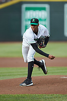 Dayton Dragons starting pitcher Hunter Greene (3) follows through on his delivery against the Bowling Green Hot Rods at Fifth Third Field on June 9, 2018 in Dayton, Ohio. The Hot Rods defeated the Dragons 1-0.  (Brian Westerholt/Four Seam Images)