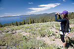 A woman hiking the Tahoe Rim Trail near Brockway Summit stops to take a picture, North Lake Tahoe