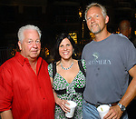 Lonnie Azzarello, Debra Gustavus and Paul Matzen at the Park Place pool party Saturday night June 20, 2009.(Dave Rossman/For the Chronicle)