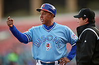 Buffalo Bisons manager Bob Meacham (12) argues a call with umpire Charlie Ramos during a game against the Pawtucket Red Sox on May 19, 2017 at Coca-Cola Field in Buffalo, New York.  Buffalo defeated Pawtucket 7-5 in thirteen innings.  (Mike Janes/Four Seam Images)