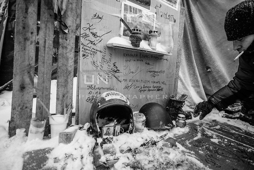 A shrine in memory of the fellow protested died has been built inside the barricades