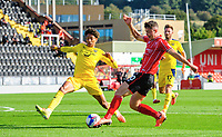 Lincoln City's Sean Roughan crosses the ball despite the attentions of Oxford United's Sean Clare <br /> <br /> Photographer Chris Vaughan/CameraSport<br /> <br /> The EFL Sky Bet League One - Saturday 12th September 2020 - Lincoln City v Oxford United - LNER Stadium - Lincoln<br /> <br /> World Copyright © 2020 CameraSport. All rights reserved. 43 Linden Ave. Countesthorpe. Leicester. England. LE8 5PG - Tel: +44 (0) 116 277 4147 - admin@camerasport.com - www.camerasport.com - Lincoln City v Oxford United