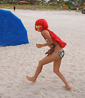 MIAMI BEACH, FL-MAY 23 2005: (EXCLUSIVE COVERAGE) Actress and this months Playboy Magazine cover girl Bai Ling enjoys a day of sun on Miami Beach. May 23, 2005.  Miami Beach, Florida. <br /> <br /> <br /> People:  Bai Ling
