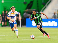 AUSTIN, TX - JUNE 19: Cecilia Dominguez #10 of Austin FC brings the ball up the field with Florian Jungwirth #23 of the SJ Earthquakes chasing him during a game between San Jose Earthquakes and Austin FC at Q2 Stadium on June 19, 2021 in Austin, Texas.